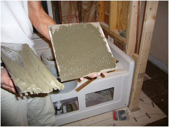 picture of Applied mortar directly to tiles for electric heating sytem